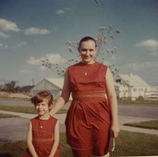 Mom and me in matching mother/daughter dresses, some time in the 1960s